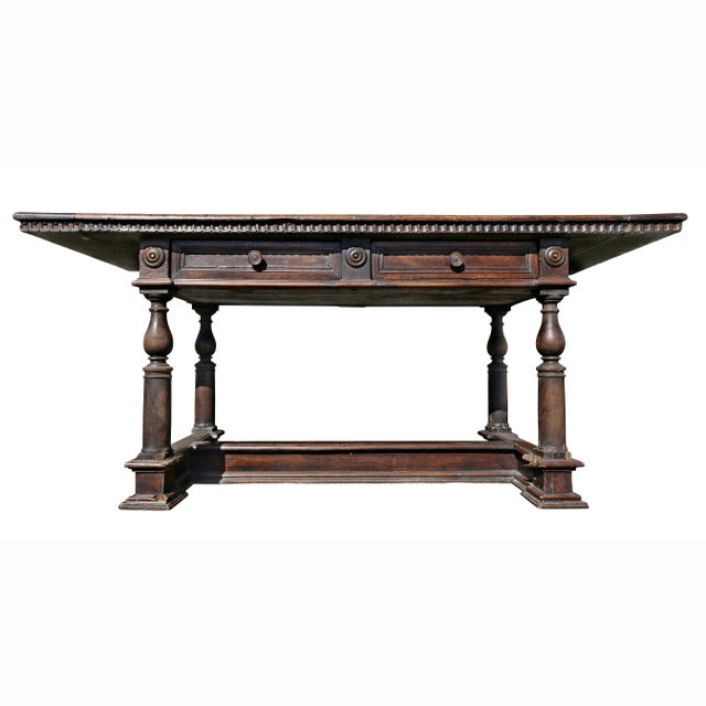 With rectangular top over two drawers raised on turned legs with H form stretcher.