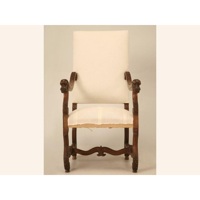 Antique French walnut Louis XIII, or Os de Mouton throne chair, with stylish carved details including figural dog...
