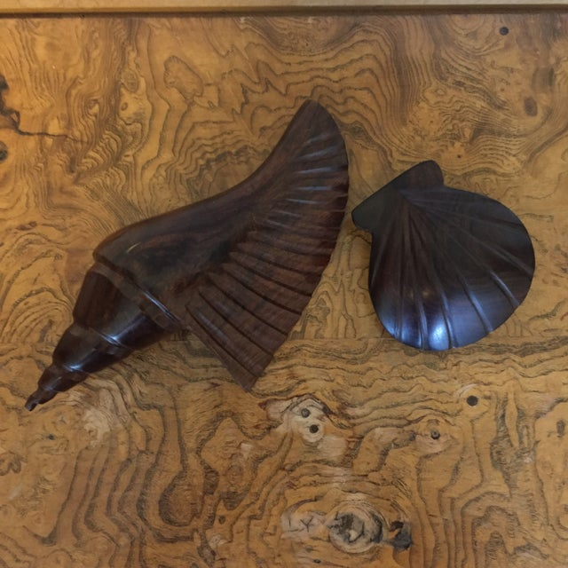"A pair of gorgeous shells carved from darker wood with beautiful grain. Conch shell measures 9"" wide, 4.5"" deep, and 3 ""..."