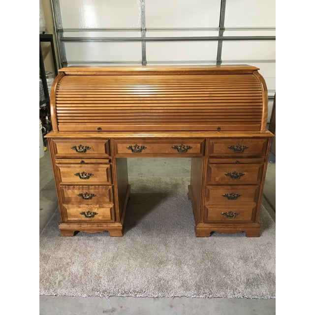 This vintage roll top desk was inherited from my Grandparents and in very good condition. The front features two large...