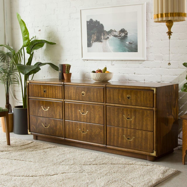This gorgeous nine (9) drawer dresser was made for you and all of your organizational needs. Classic campaign style made...