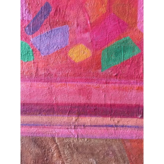 Gorgeous colorful abstract geometric painting featuring shapes and stripes in red, pink, gold and blue.