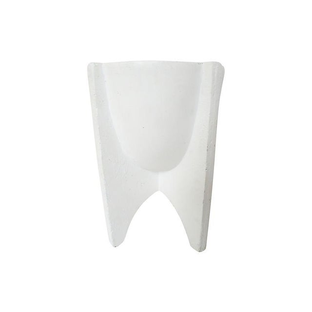 Heavy cast plaster footed cachepot with semi-smooth white plaster finish. Recommended for indoor use.