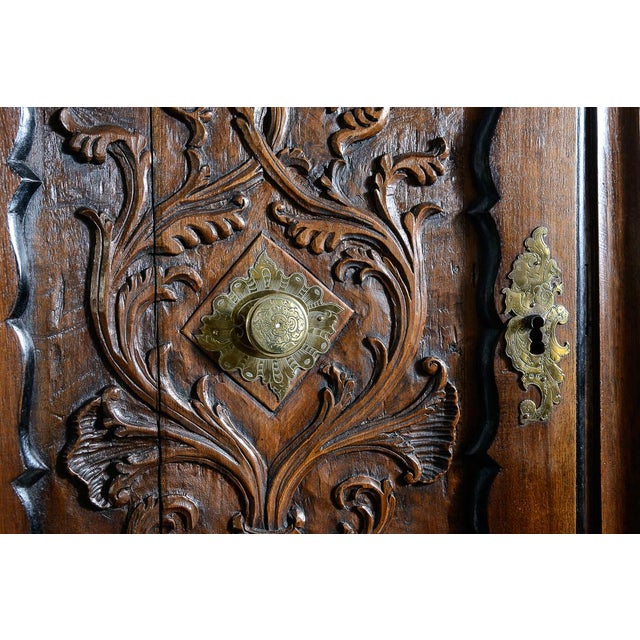 18th Century, Portuguese walnut and ebonized cabinet. Heavily carved drawer fronts of the four seasons with large...