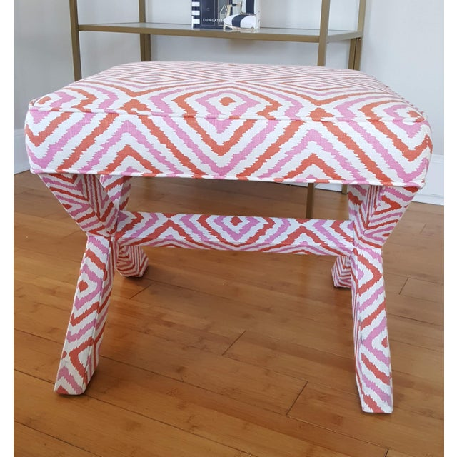 Chic and versatile, this upholstered x-base ottoman from Jonathan Adler will add a pop of color and comfort to your home....
