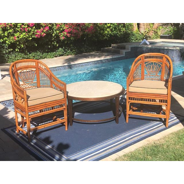 Pair Bali Bamboo accent chairs with like new original cane seat. The chairs are in perfect condition. There are visible...