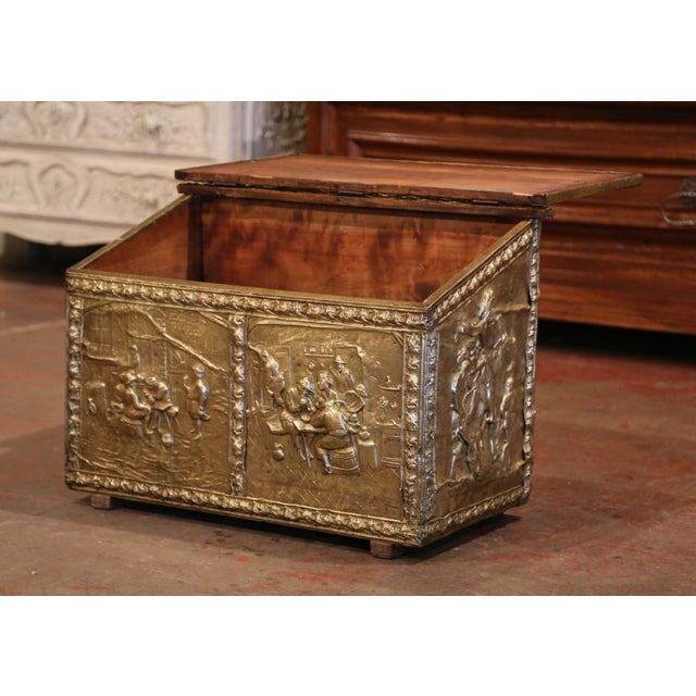 Crafted in France, circa 1870, the antique copper coffer stands on wooden feet; the slant top opens up with inside...