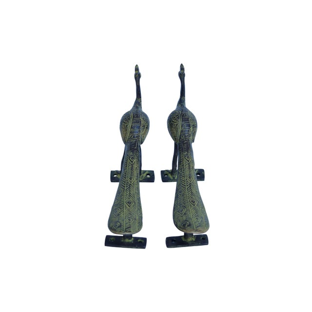 A pair of large green brass peacock door handles or cabinet pulls. Hollywood Regency in style, with intricate carving...