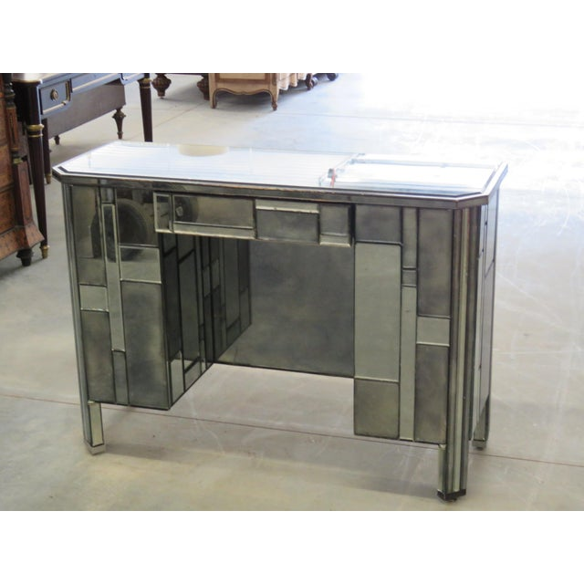 Modern design abstract desk with ebonized wood, a distressed mirror finish, one drawer and two side doors that each...