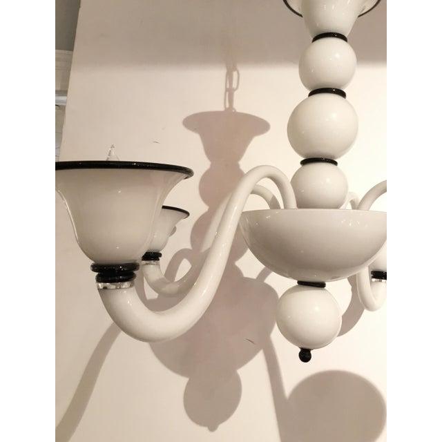 Original Retail: $3900, stylish Italian Modern Black and White Glass Chandelier, showroom floor sample