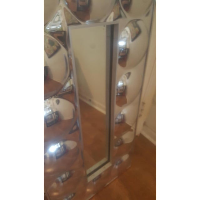 Small atomic rectangular bubble frame with rectangular mirror in the center. Perfect for a small bathroom or powder room.