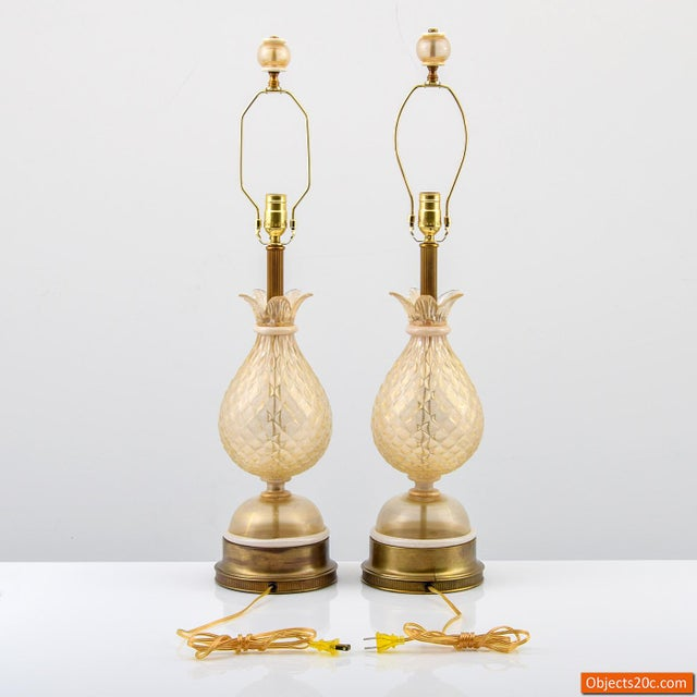 Pair of quilted blown glass pineapple form lamps with gold aventurine throughout and matching finials attributed to...