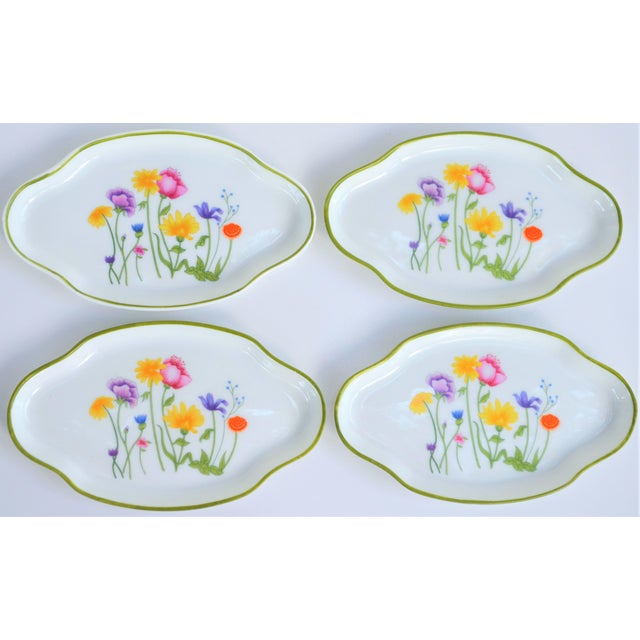 This is a beautiful set of Limoges French small oval plates. They are floral in design with roses and mini buds and in a...