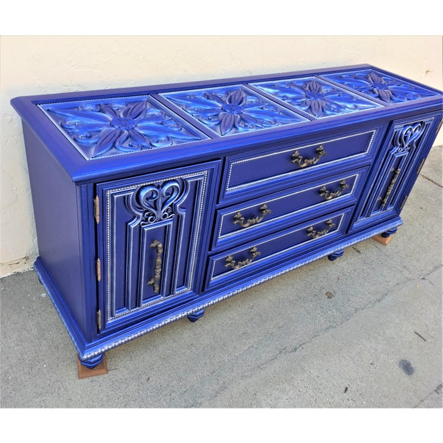 Vintage Hollywood Regency solid wood Rococo 9-drawer dresser by Bassett painted in metallic sapphire blue with silver...