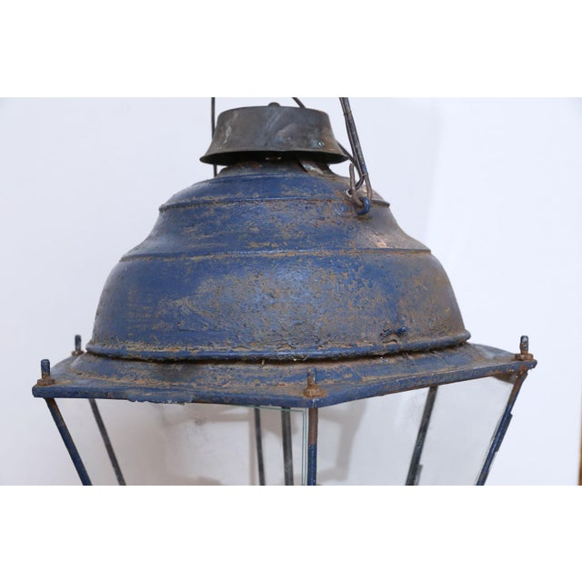 Lantern Large late 19th century blue-painted hexagonal tole lantern from France. Newly-wired for three candelabra-size...
