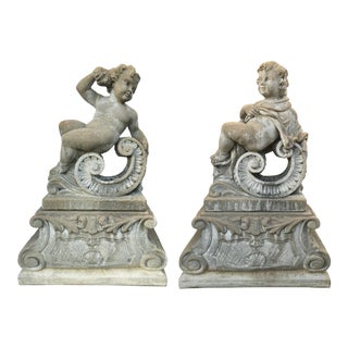 Classical Stone Composite Putti Garden Statues Holding Roses and Cloth - A Pair For Sale
