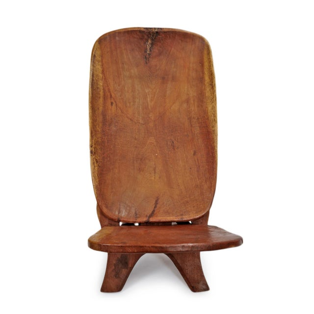 Wonderful and simple Senufo stargazer solid wood folding chair. From the Senufo people. Hand carved indigenous wood with...