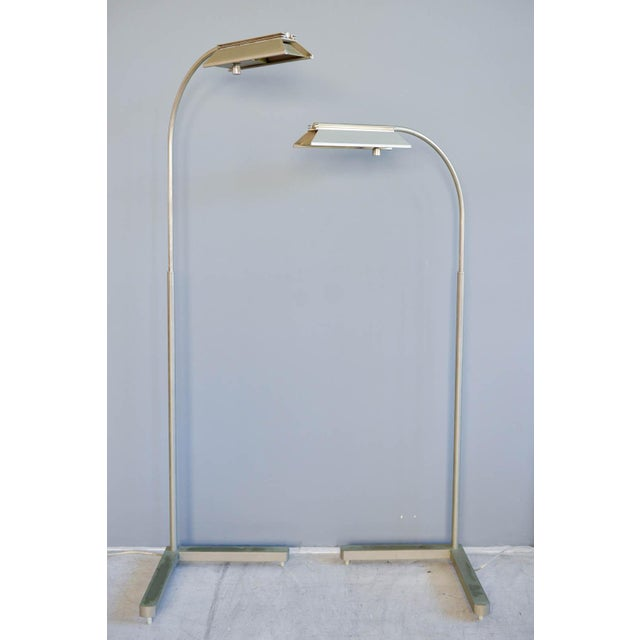 Pair of brushed nickel adjustable dimmable floor lamps by Casella, circa 1970. Good vintage condition, with original...