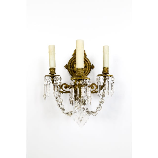 A striking pair of elaborate, French sconces in the Belle Epoque style. The detailed, solid brass structure is extra deep,...