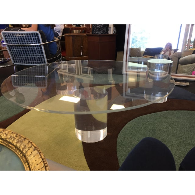 "Important lucite coffee table in the style of Charles Hollis Jones. Three massive lucite columns supporting a 3/4"" lucite..."