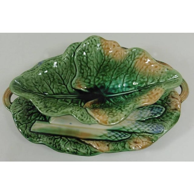 Rare Majolica asparagus sauce boat attributed to Creil et Montereau. The piece is decorated with cabbage leaves and...