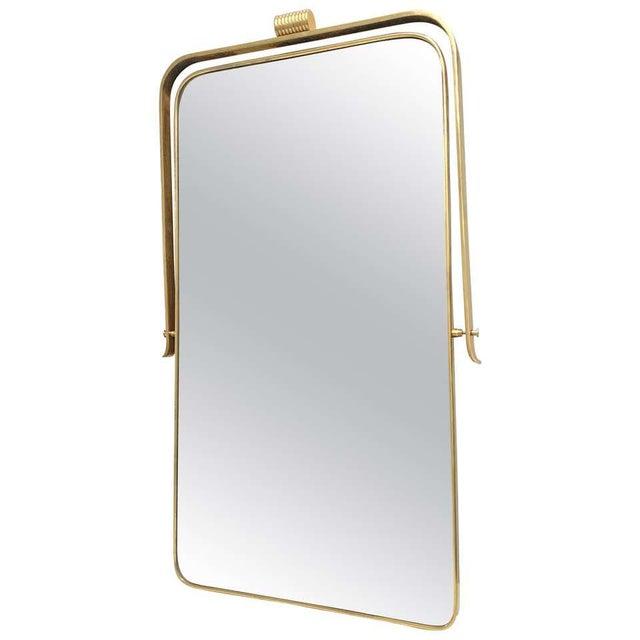 Italian brass frame mirror, circa 1950s attributed to Gio Ponti with a distinctive design circa 1950s and 1960s. Good...