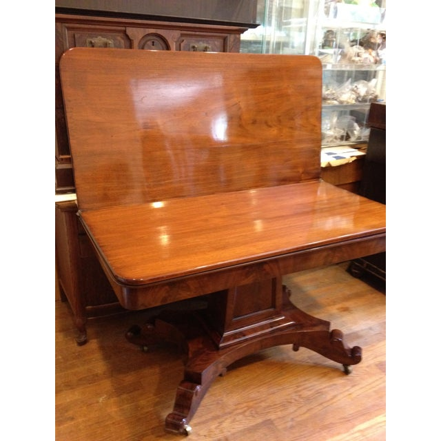 This is an Civil War Era, flame, burl mahogany empire swivel-top game table. This table is in very good shape for its age....