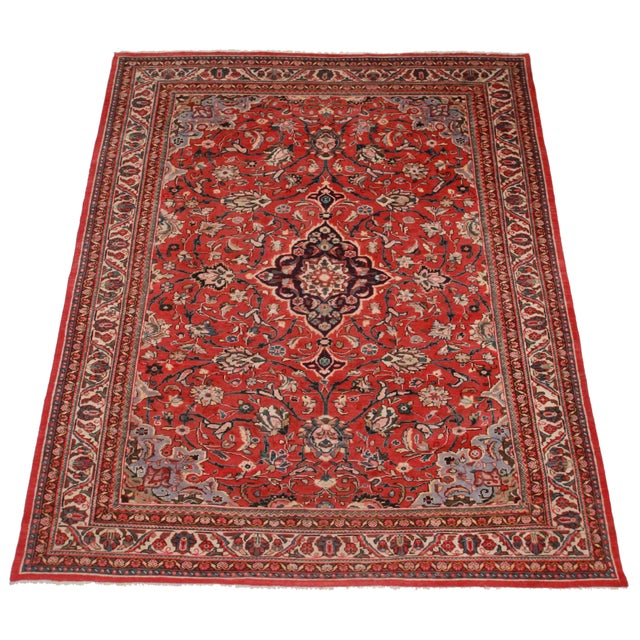 Crafted of hand-knotted wool, this Persian Mahal rug features an all-over floral design.