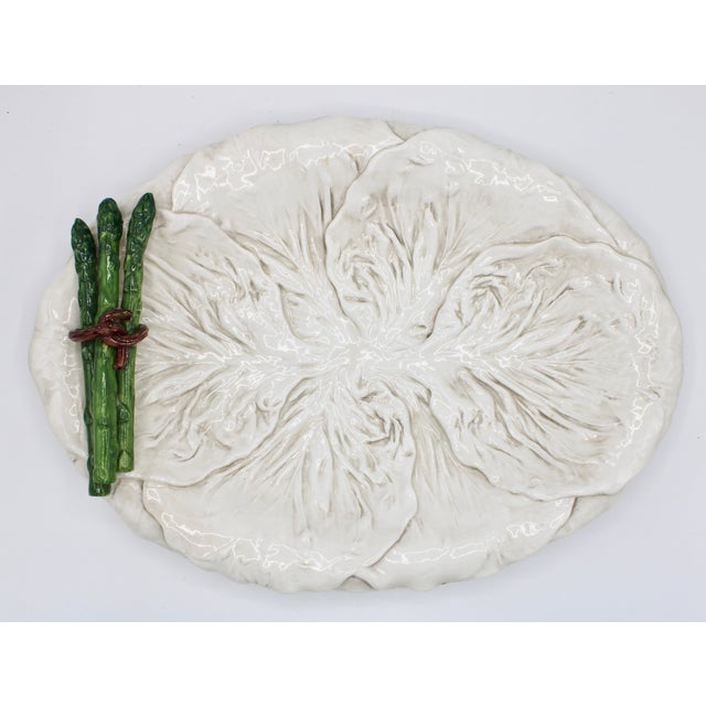 A superb Mid 20th Century Italian White Ceramic Cabbage Leaf Platter with three sculptural asparagus stalks bound together...