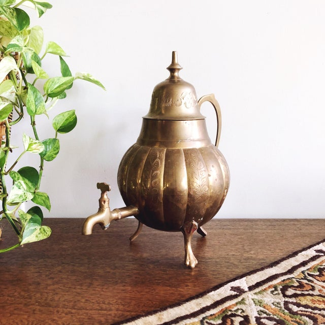 Vintage brass samovar tea pot. Made in India, circa 1950s. The brass is etched with intricate detail and the inside is...