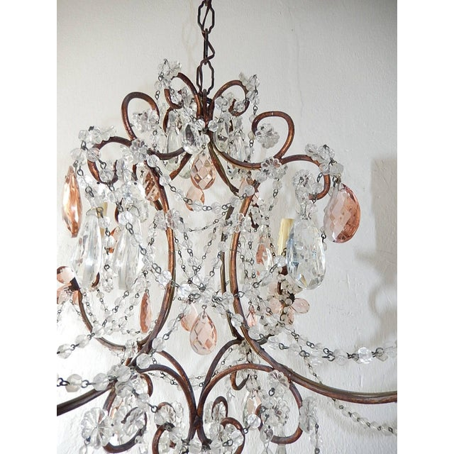 Housing four lights, sitting on chippy gold giltwood posts. Rewired and ready to hang. Loaded with florets, swags of...