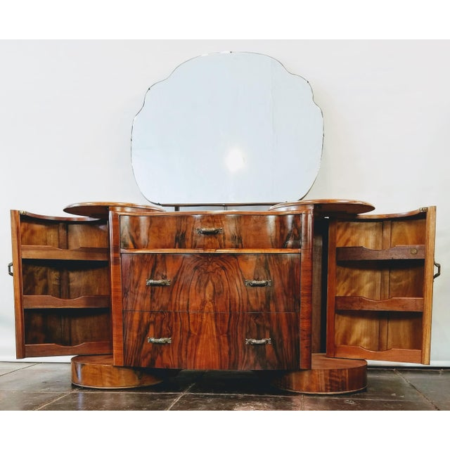 Vintage Art Deco style burl walnut vanity with shaped, tilting mirror manufactured by Shrager Brothers Masterpiece...