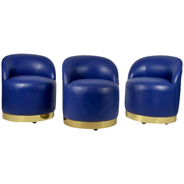 Karl Springer Style Chairs in Blue Leather with Brass Finish Base on Casters For Sale