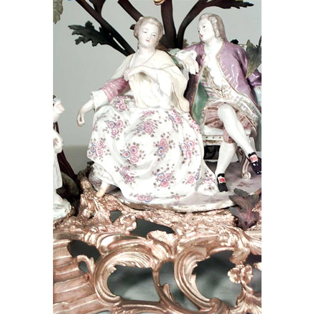French Louis XV style (19th Century) bronze doré and porcelain floral decorated mantel clock with four 18th century style...
