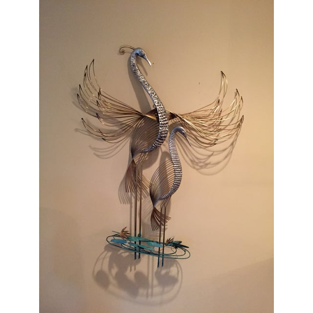 Gorgeous very unusual intricate C. Jere signed wall sculpture. This beautiful bronze and golden pair of cranes are in a...