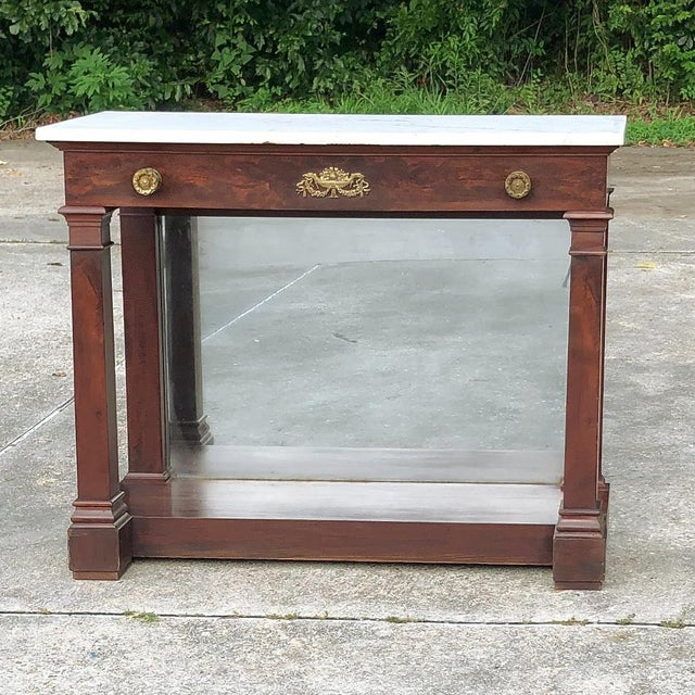19th Century French 2nd Empire Period Marble Top Console was meticulously hand-crafted by top artisans during the Golden...
