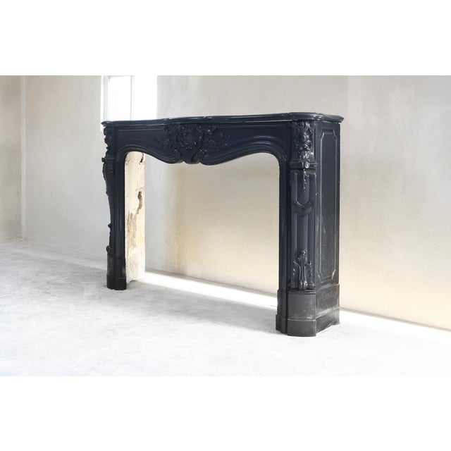 A beautiful 'Noir de Mazy' fireplace. Noir de Mazy is black marble and comes from Belgium. This type of marble is becoming...