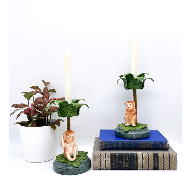 Stunning pair of Hollywood Regency/Palm Beach style monkey and palm tree candleholders. This pair features heavy...