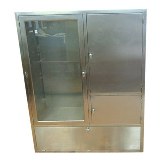 1950s Stainless Steel With Glass Door Fronts and Adjustable Stainless Shelving Built In Storage Cabinet For Sale