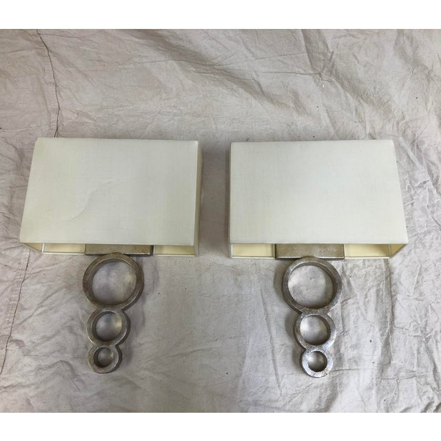 Pembroke Wall Sconce by Currey & Company - Showroom Sample Wall sconce with three wrought-iron graduating rings in a...