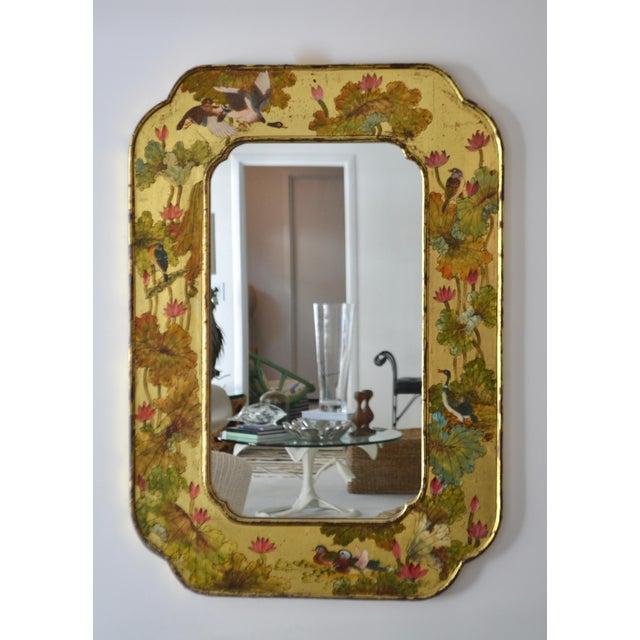 Stunning Hollywood Regency hand-painted giltwood wall mirror, circa 1960s. This glamorous chinoiserie gold leafed mirror...