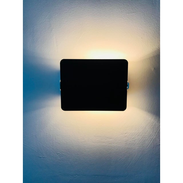 Charlotte Perriand plastic CP-1 sconce light. Designed by Charlotte Perriand for Les Arcs 1600. The body is white plastic...