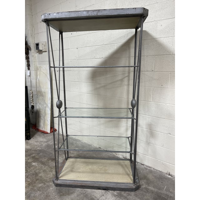 This a very cool heavy iron and glass etageres. 4 shelves total with 3 glad and the bottom shelf is solid with a crackle...