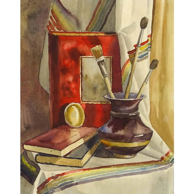 Charming framed American-school water color still life with curtain, books, brushes and vessel. Unsigned in burgundy wood...