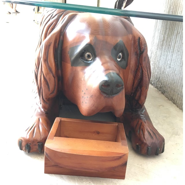 About 20th century country carved table featured a lifesize lovely dog with crystal top secret compartment under de nose...