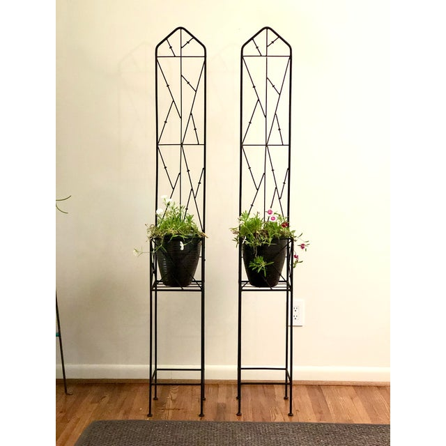 Great pair of square plant stands made of black iron with trellis back panels in a modern lattice pattern. Perfect for...