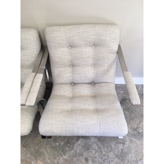 Sleek styling in newly upholstered neutral fabric!