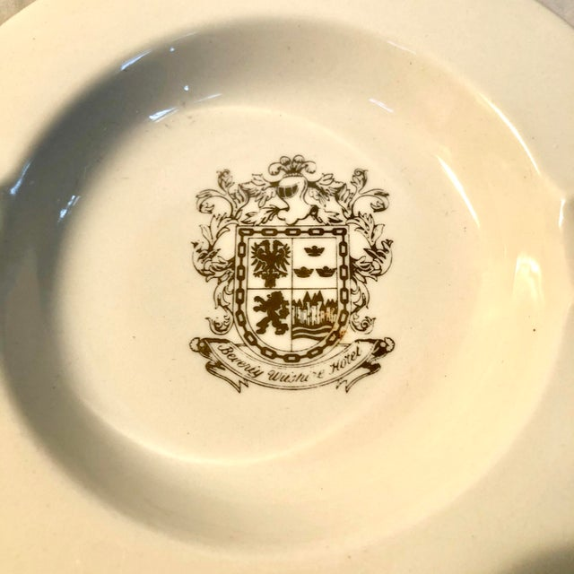 Ceramic ashtray from the famed Southern California landmark Beverly Wilshire Hotel has banded gold rim and stamped gold...