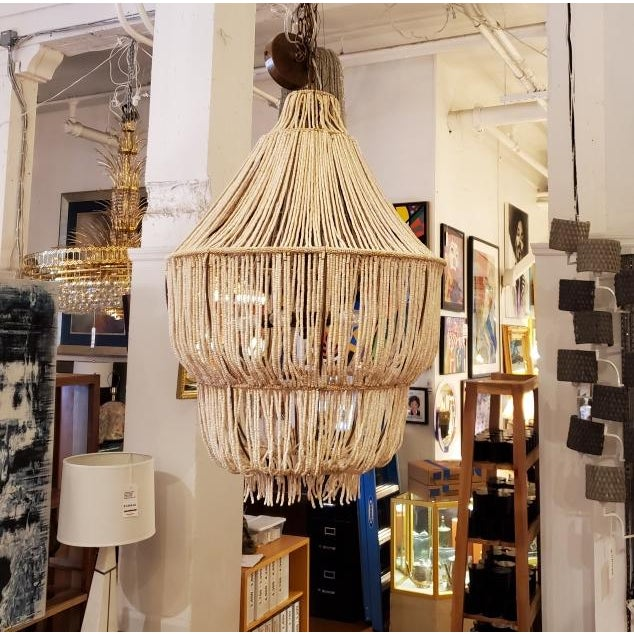 Design Plus Gallery presents a Made Goods CoCo Bead Aida Chandelier. This empire chandelier is draped with hand-strung...