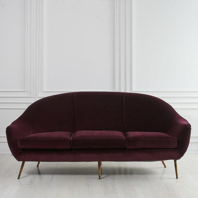 A curvy Italian loveseat from the 1960's. We have lovingly restored this piece and it features a rich aubergine velvet,...